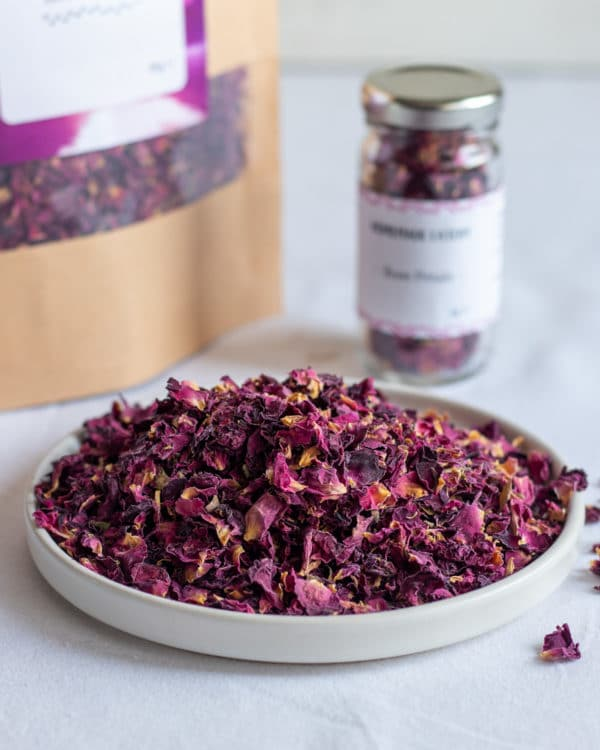 Dried Rose Petals on plate with pouch and jar behind
